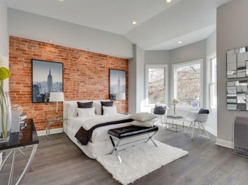 ideen schlafzimmer eklektisch weißer teppich schwarze sitzbank hellgraue wände