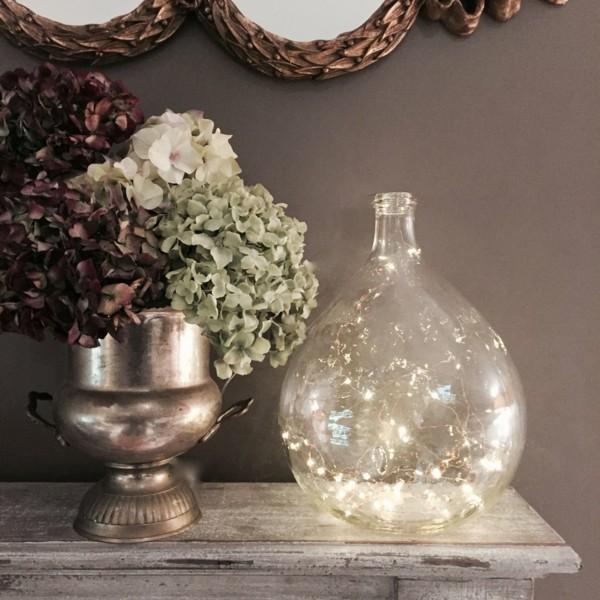 lichterketten dekoideen kommode glasflasche rund hortensien