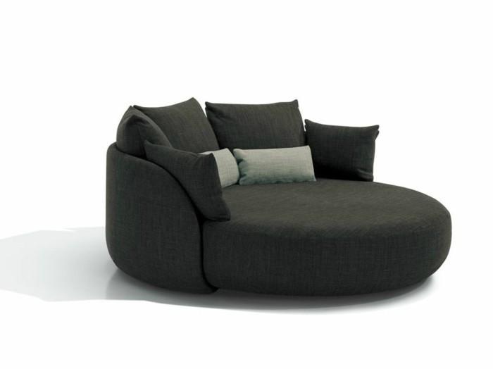 rundes sofa elegantes design dunkelgrau dekokissen