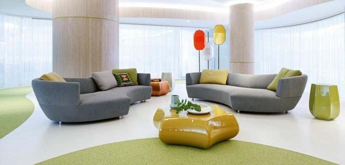 rundes sofa graue rundsofas ausgefallener gelber couchtisch schöner bodenbelag