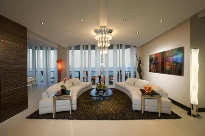 rundes sofa rundsofas weiß zwei wohnzimmer einrichten couchtisch glas blumen