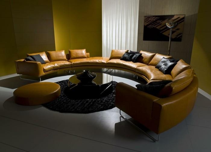 rundes sofa schickes ledersofa schwarzer teppich