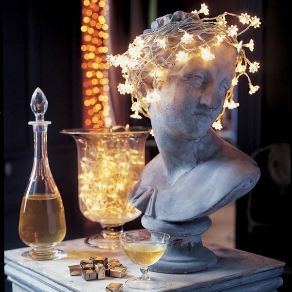 sterne lichterketten dekoideen antike statue kommode dekorieren