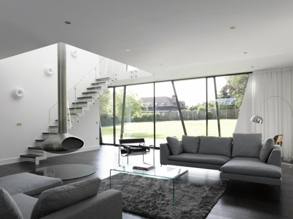 zimmer einrichten hellgraue wohnzimmermöbel transparenter couchtisch