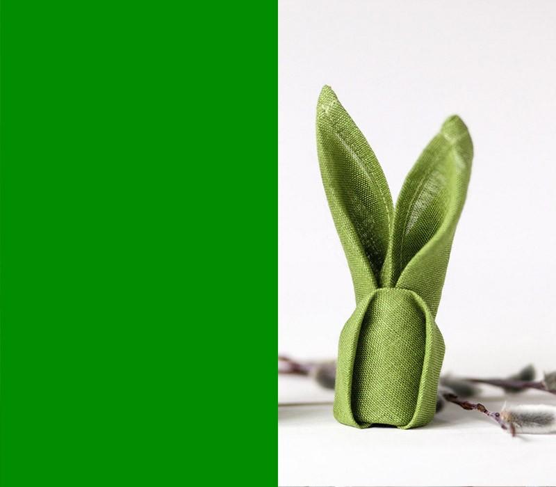 Bedeutung der Farben grüne Serviette in Hasenform falten