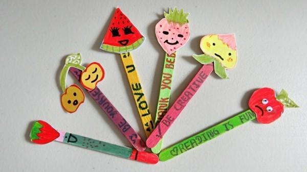 Lesezeichen basteln mit Kindern Eisstiele Obst aus Papier schneiden
