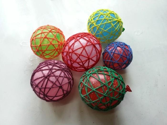osterdeko selber machen basteln mit wolle filz umwickeln ballon