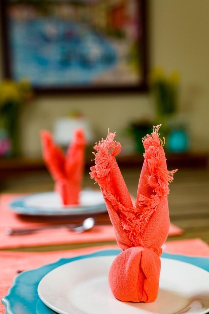 osterhase basteln servietten falten anleitung stoffserivetten rot