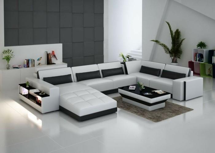 weißes designer sofa mit schwarzen deko kissen