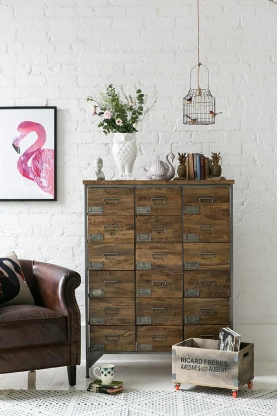 moderne kommode vintage industriell hängelampe weiße steinwand