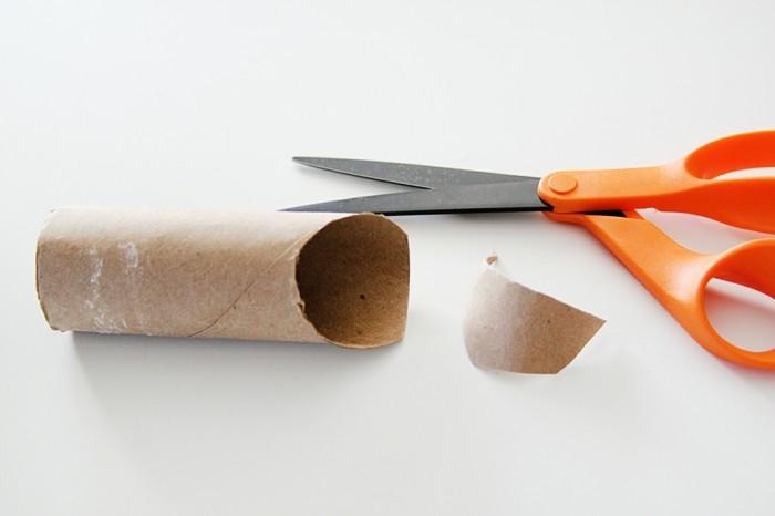 osterdeko selber machen basteln mit klopapierrollen schere