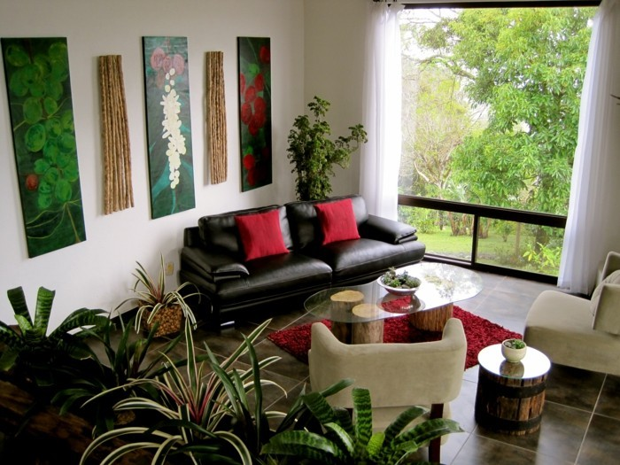 pflanze mit großen blättern frisches innendesign wohnzimmer rote akzente