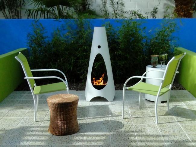 Feuerstelle Design kleiner Rückzugsort grüne Pflanzen