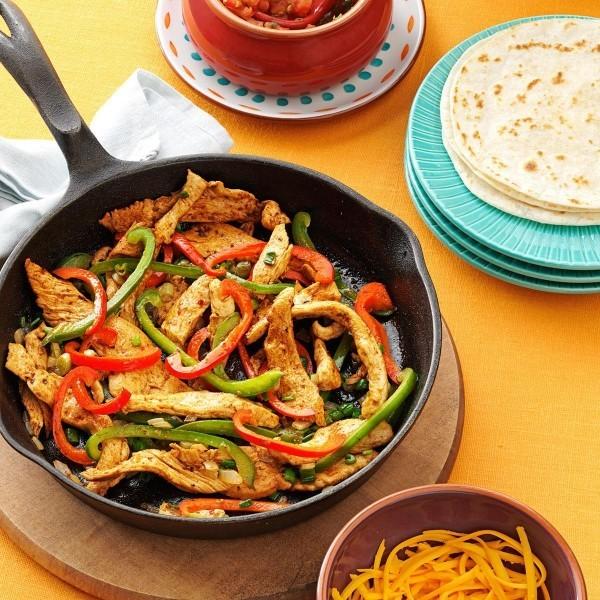 Mexikanische Gerichte Schweine Stücke Gemüse Pfanne perfekte Füllung Tacos