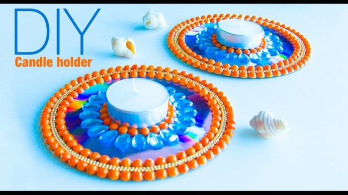 recycling bastelin mit cds upcycling ideen wand deko ideen kerzenstaender