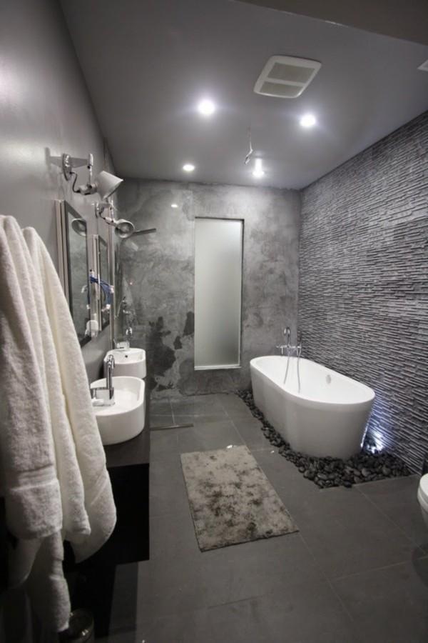 badezimmer grau weiße badewanne steine