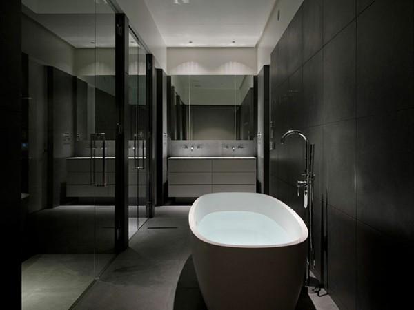 badezimmer schwarz große schwarze badefliesen ovale weiße badewanne