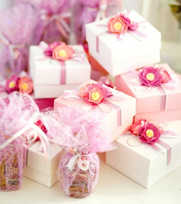Gifts boxes for guests in rose color with ribbon
