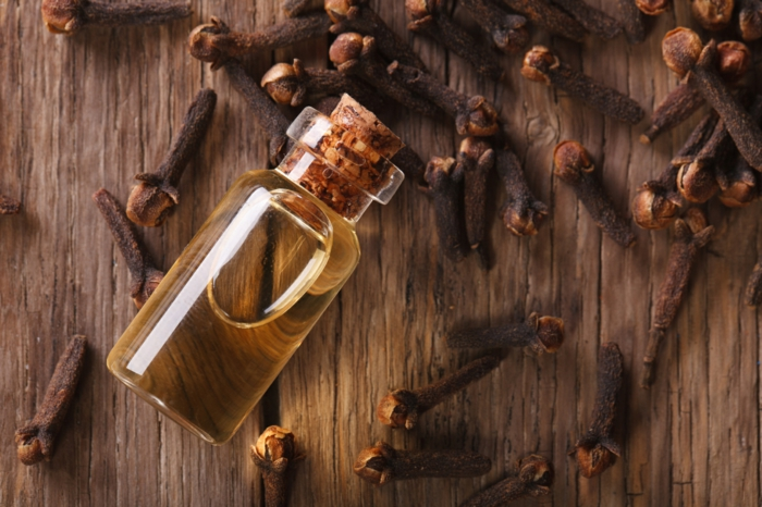 Oil of cloves close-up on the table. horizontal top view