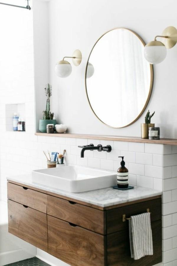 runder badspiegel design weiße badezimmerfliesen moderner waschbeckenunterschrank