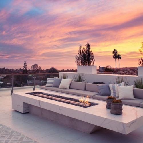 terrassenkamin offene feuerstelle den sonnenuntergang genießen