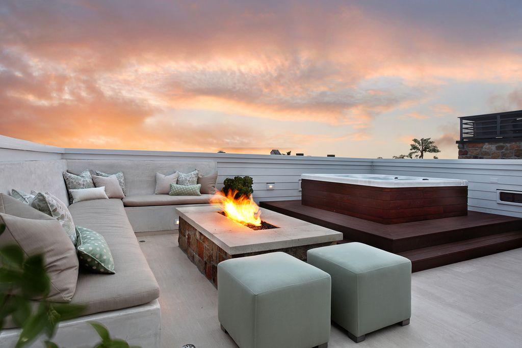 terrassenkamin viele sitzgelegenheiten sonnenuntergang