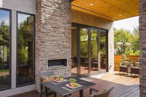 terrassenkamin wohnlihe terrasse gestalten rattanmöbel