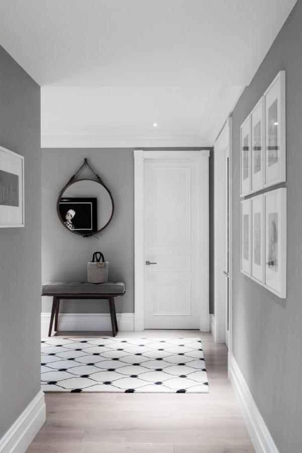 wandfarbe hellgrau flur gestalten ideen eleganter teppich weiß schwarz