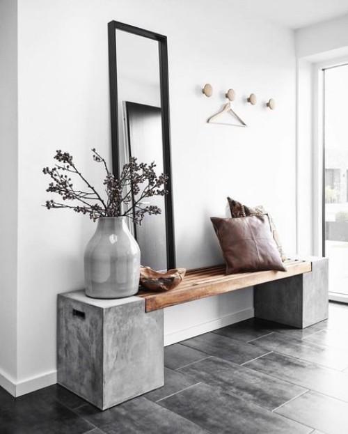 Flur gestalten - schlichte Sitzbank minimalistisches Raumdesign viel Beton Grau