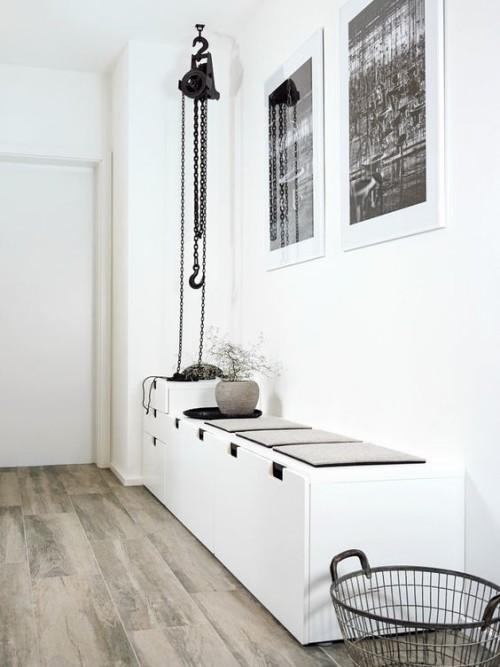 Flur gestalten weiße Wände Gestaltung in weiß grau schwarze Akzente