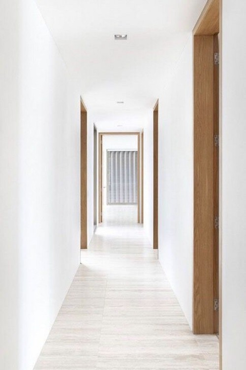 Flur gestalten weiße Wände visuelle Täuschung Flur sieht breiter aus
