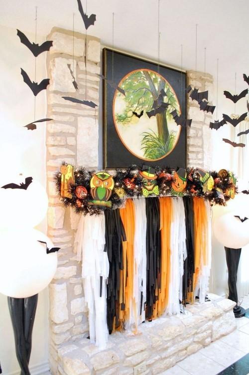 Deko Ideen zu Halloween den Kaminsims dekorieren Kürbisse