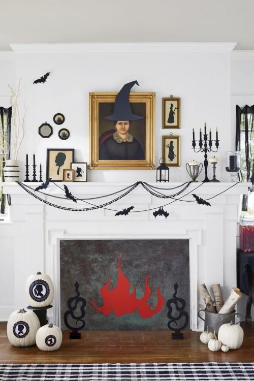 Schattenbilder auf weißen Kürbissen tolle Deko Ideen zu Halloween den Kaminsims schmücken