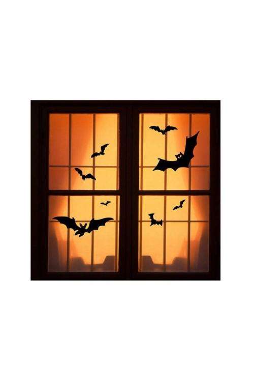 Halloween Fensterdeko schwarze Fledermäuse auf orangenfarbenem Hintergrund gut beleuchtet
