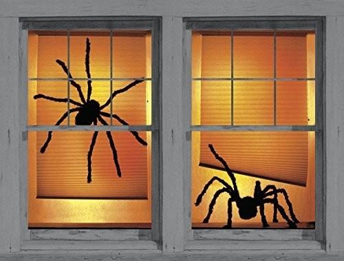 Halloween Fensterdeko zwei große schwarze Spinnen orangenfarbenem Hintergrund gut Beleuchtet