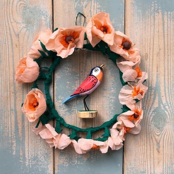 weihnachtsbastelideen wehachtskranz mit einem vogel