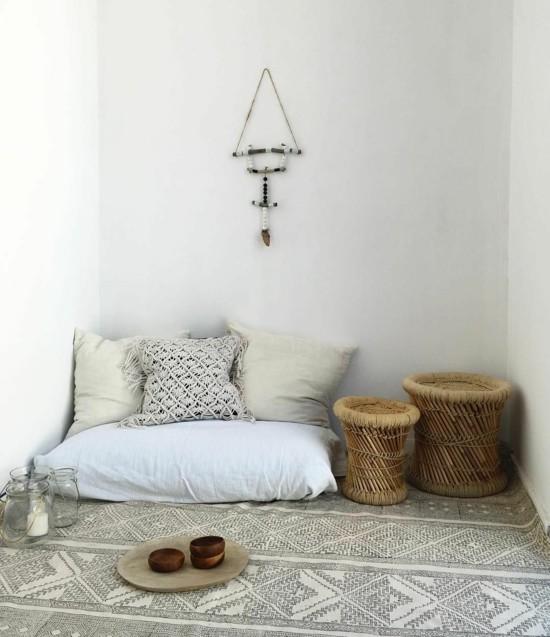 boho style furnishing with floor cushion throw pillow