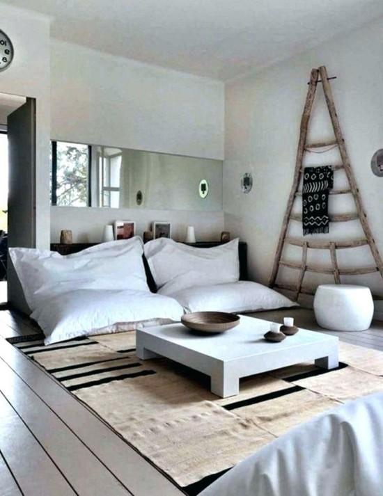 scandinavian set up with floor cushions