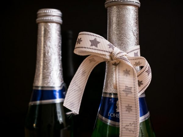 Christmas presents make bottles with champagne
