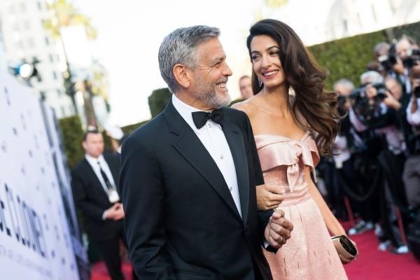 Amal und George Clooney bekannt für ihre philanthropischen Ativitäen