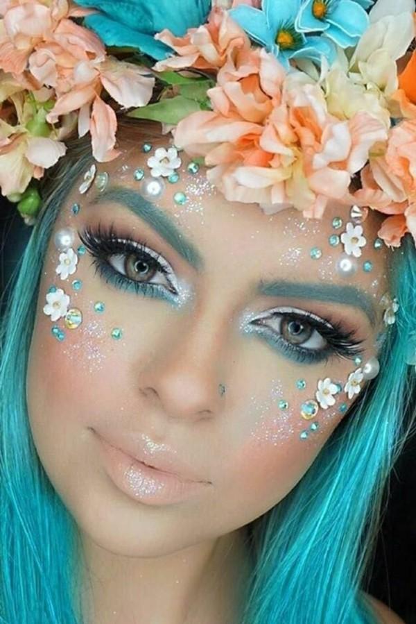 Meerjungfrau schminken strasssteine und blumen