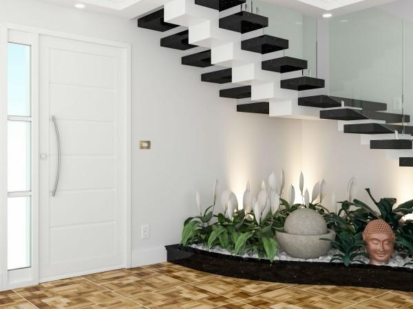 Treppenhaus Pflanzenbeet mit asatischen Skulpturen