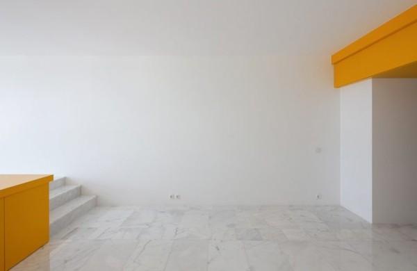 Kleine Wohnung minimalistisches Raumkonzept gelbe Akzente ideen
