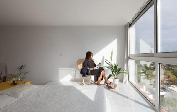 Kleine Wohnung verglaste Wand sonnige Leseecke gestaltet