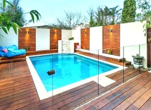 Zaun um Pool Ideen viel Holz gute Beleuchtung sehr ansprechend