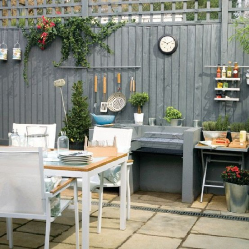 Outdoor Küche einfaches Design Arbeitsplatten aus Beton Holzlatten Sichtschutz