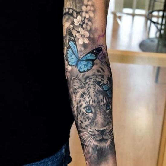 schmetterling leopard sleeve tattoo ideen