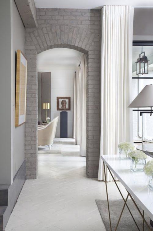 Halbkreisfenster gewölbte Zimmerdurchgänge Ziegelbogen viel Licht guter Durchblick modernes Designkonzept