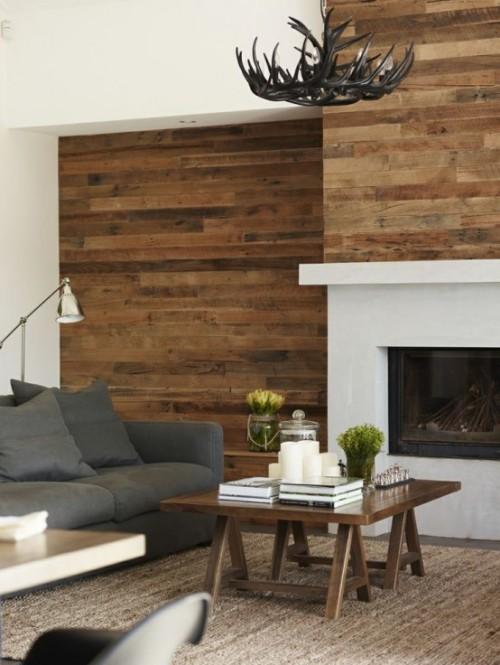 Akzentwand moderne Wandgestaltung dunkles Holz Wohnzimmer im Landhausstil