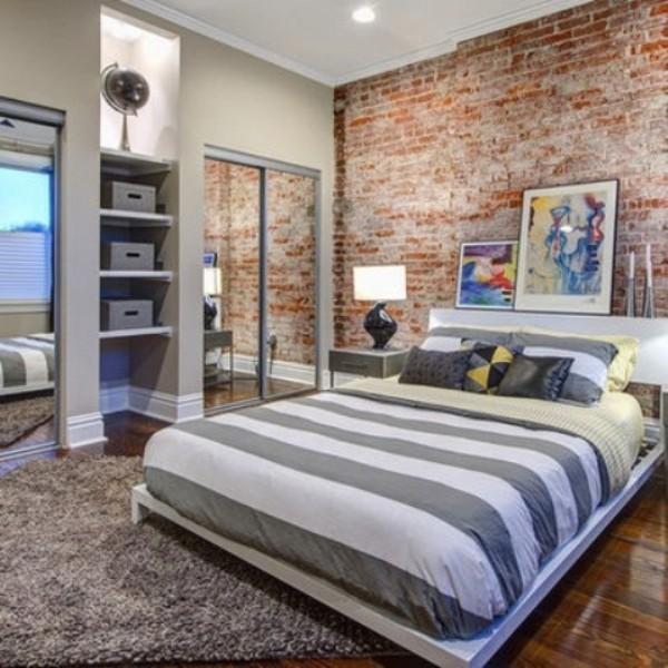 Backsteinwand im Schlafzimmer moderne Gestaltung grau dominiert